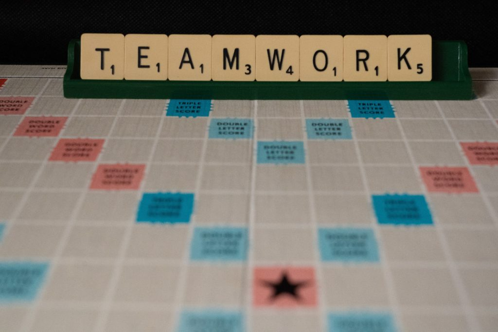 Teamwork made with Scrabble pieces